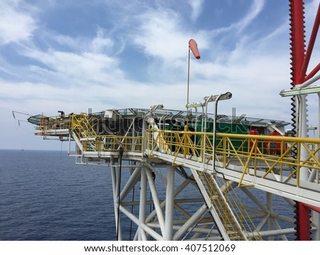 Helideck of oil and gas drilling rig in offshore industry - stock photo