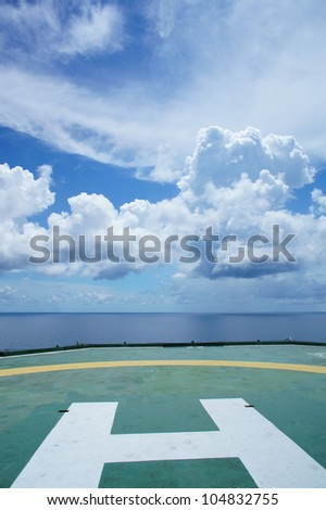 Helideck of Oil Drilling Rig in The Middle of Ocean - stock photo