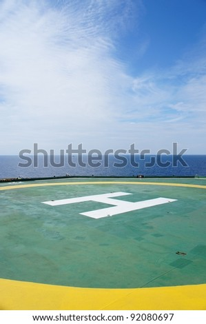 Helideck of Oil Drilling Rig In The Middle of The Sea - stock photo