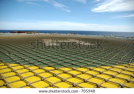 Helipad abstract on offshore oil rig - stock photo