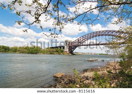 Hell gate bridge in New York framed by a tree