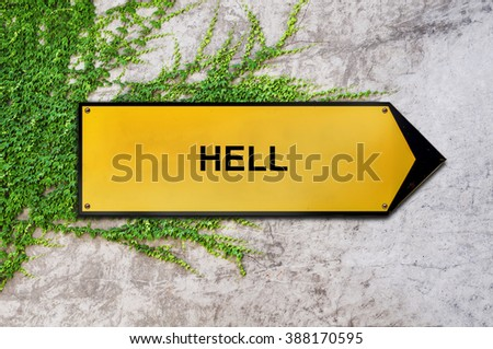 Hell on yellow sign hanging on ivy wall - stock photo