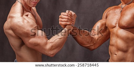 Hello athletes. Two bodybuilders shake hands - stock photo