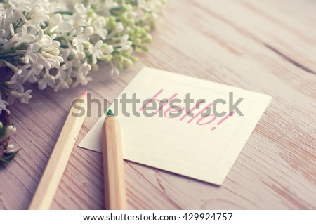 ... of a white lilac and the white card with the inscription
