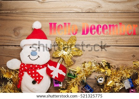 Hello December Message On Wood, Christmas Ornaments And Snowman On Old Wood  With Text Hello