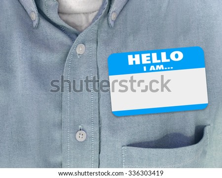 Hello I Am blank name tag worn by person in blue button shirt - stock photo