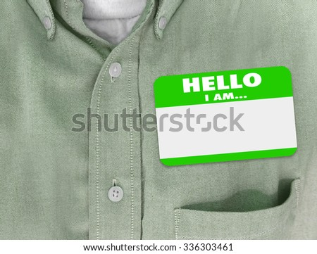 Hello I Am blank name tag worn by person in green button shirt - stock photo
