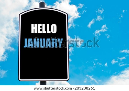 HELLO JANUARY motivational quote written on road sign isolated over clear blue sky background with available copy space. Concept  image