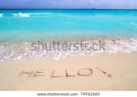Hello message spell written in tropical beach sand Caribbean turquoise sea - stock photo