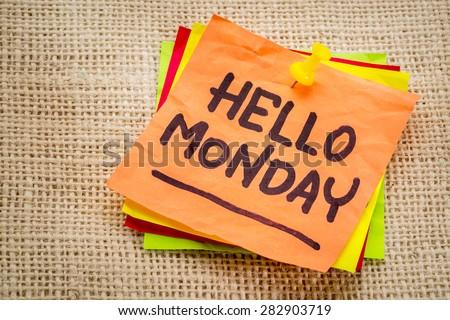 Hello Monday cheerful handwriting on sticky note - stock photo