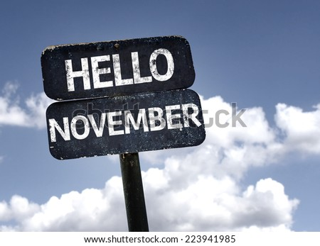 Hello November sign with clouds and sky background - stock photo