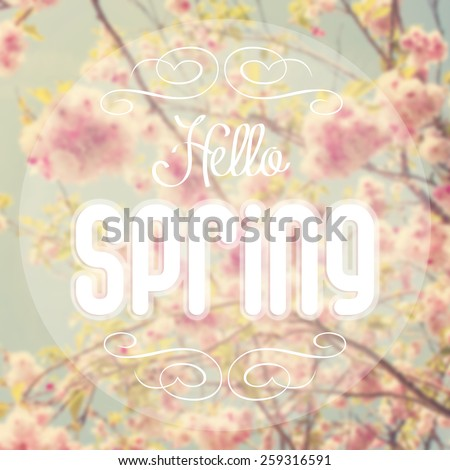 Hello spring text with out of focus spring background. - stock photo