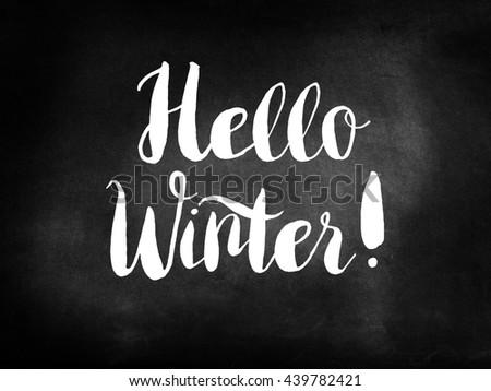 Hello Winter on a chalkboard - stock photo