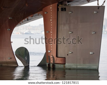 helm and propeller on the new boat - stock photo