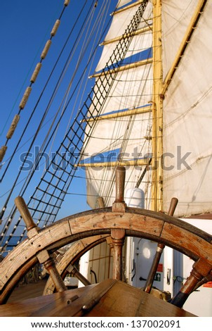 Helm and sail the ship - stock photo