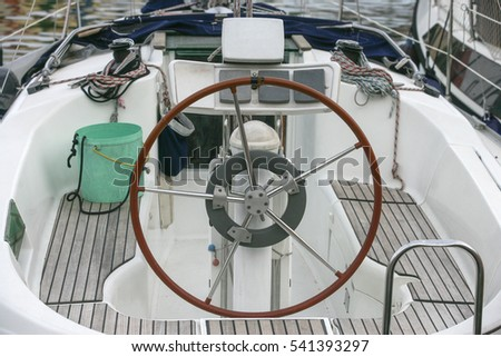 stock-photo-helm-boat-moored-541393297.j