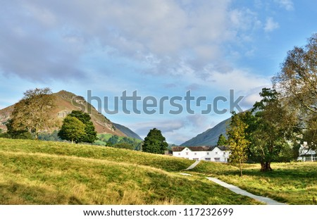 Helm Crag viewed from Grasmere, on a summers day. - stock photo