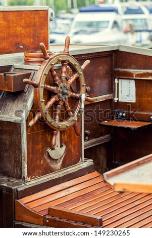 helm of sailing boat - stock photo