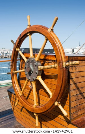 Helm (steering wheel) of a sailing ship - stock photo