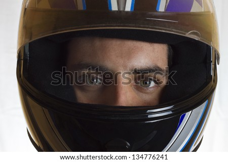 Helmet and eyes.Man with a motorcycle helmet. - stock photo