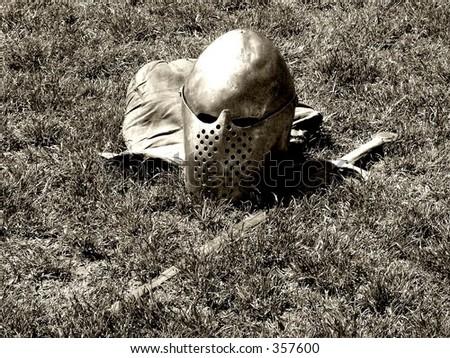 Helmet and sword (sepia) - stock photo