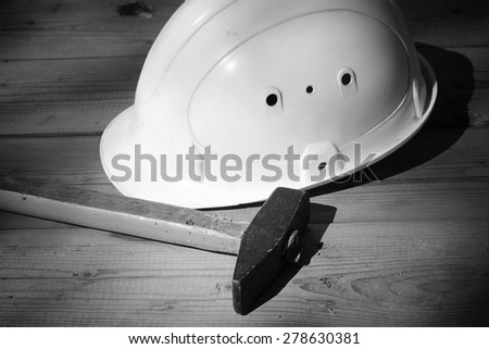 helmet and tools hammer