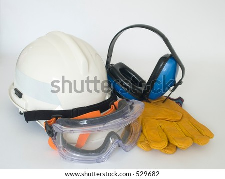 Helmet, gloves, ear defenders and goggles - stock photo