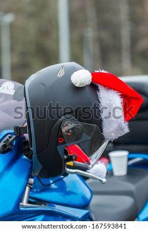 Helmet on a motorcycle of Santa Claus. - stock photo