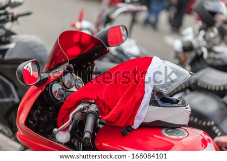 Helmet on a motorcycle of Santa Claus - stock photo