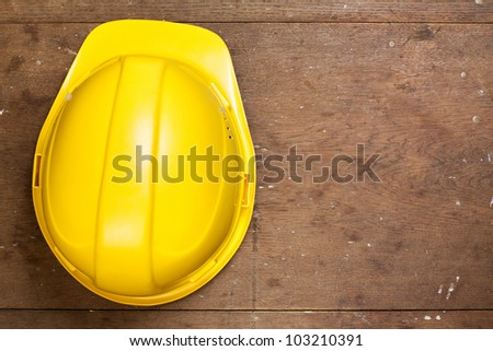 Helmet on grunge oak wood - stock photo