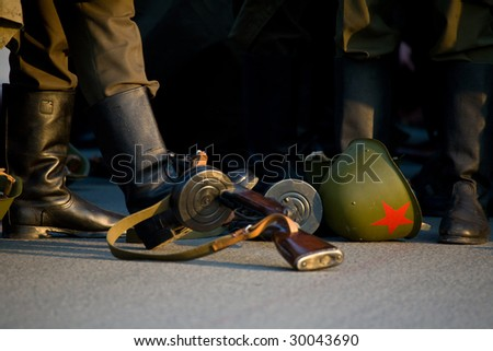 helmet with red star, old assault rifle and soldier boots - stock photo