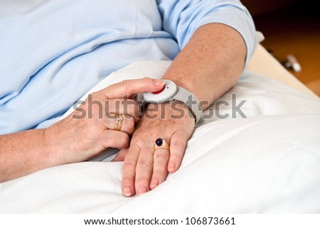 help a senior citizen with emergency phone call in bed