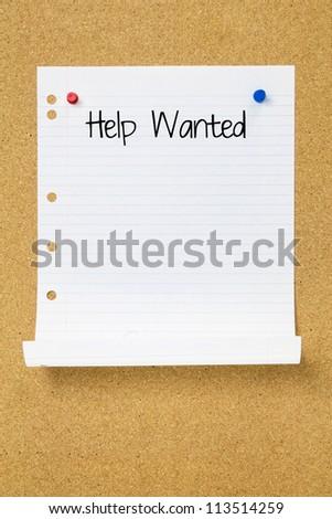 Help Ad on Cork Board - stock photo