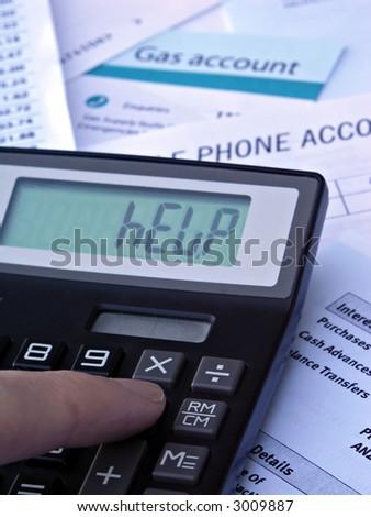 HELP - Calculator & bills - stock photo