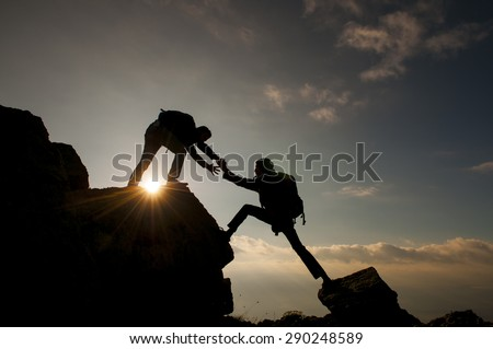 help climbing mountain - stock photo