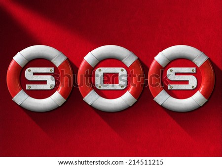 Help Concept - Red and White Lifebuoys / Three red and white lifebuoys hanging to a red velvet wall with the text SOS - Concept of help - stock photo