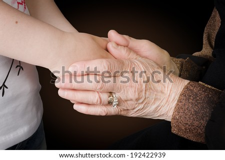 Help concept, young and elder hands - stock photo