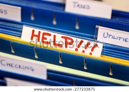 HELP In Bold Red Letters/ HELP File  - stock photo