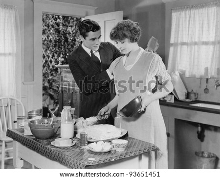 HELP IN THE KITCHEN - stock photo