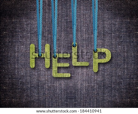Help Letters hanging strings with blue sackcloth background. - stock photo