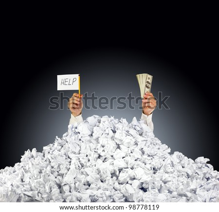 Help me! Person under crumpled pile of papers with hand holding a help sign and money