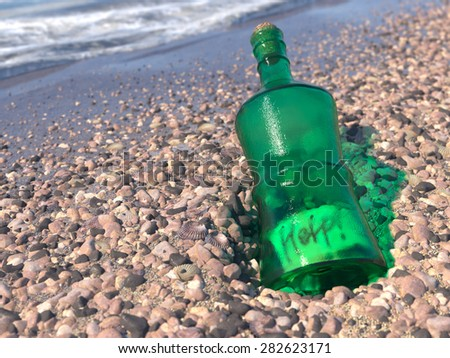 Help Message in a bottle on a shore concept background - stock photo