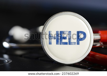 Help sign and stethoscope. Help sign and stethoscope. Medicine concept on computer keyboards - stock photo