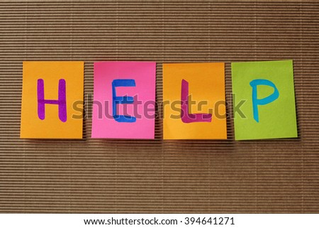 help text on colorful sticky notes - stock photo