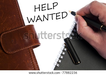 Help wanted write by male hand - stock photo