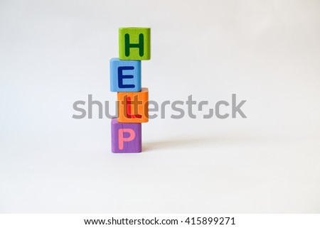 HELP word written on wood blocks, white background with copyspace - stock photo
