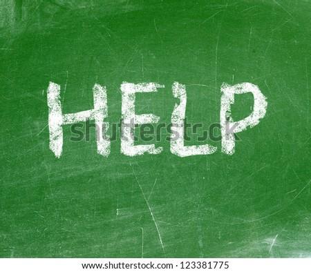 Help written on a blackboard. - stock photo