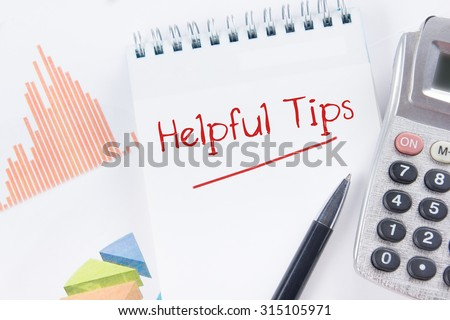 Helpful Tips concept - Financial accounting stock market graphs analysis. Calculator, notebook with blank sheet of paper, pen on chart. Top view - stock photo