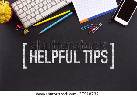 HELPFUL TIPS CONCEPT ON BLACKBOARD - stock photo