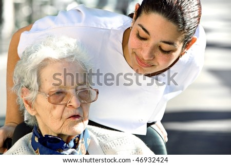 helping an old woman - stock photo